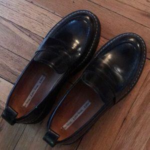 Black platform loafers